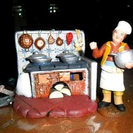 cucina-con-fuoco-e-cuoco